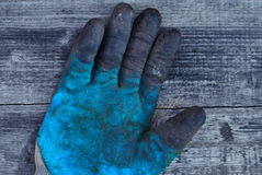 Old work glove, rubber glove, protective glove, professional hand protection, the glove is worn, dirty glove Royalty Free Stock Images