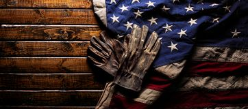 Free Old Work Gloves On Large American Flag - Labor Day Background Royalty Free Stock Image - 155685846