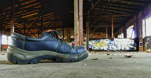 Old work shoe Stock Images