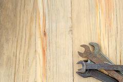 Old work tools spanner, wrench on a wooden table. Royalty Free Stock Photos