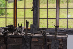 Old workbench with vices. Old workbench with various tools and machines Stock Photos