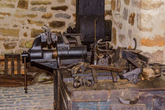 Old workbench with vices. Old workbench with various tools and machines Royalty Free Stock Photos