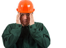 A worker having a migraine isolated on white  background Royalty Free Stock Images