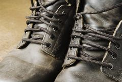 Old working boots and rust. Old working-boots against rust Royalty Free Stock Images