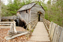 Old working grist mill in winter season. An old grist mill still operates in winter season Stock Photography
