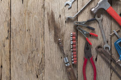 Old working tools on old wood background Stock Images
