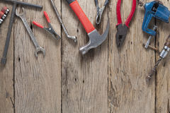 Old working tools on old wood background.  Stock Photos