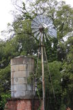 Old working windmill with cistern. This picture was take in Weatherford Texas on 180 west of downtown in the summer of 2016 Stock Image