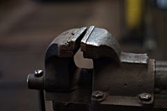 Old workshop vice. Very old indestructible workshop vice used for car repairs withstands the impact of a heavy hammer beautiful monument Royalty Free Stock Photos