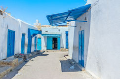 The old workshops. The working neighborhood with many weaving workshops and draperies in Medina of Kairouan, Tunisia Royalty Free Stock Image