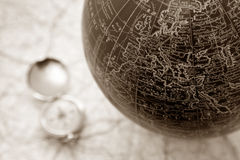 Old world. An ancient map of the world with a compass on the backgorund Stock Photo