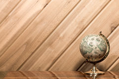 Old World Globe against Plank Wall with Copy Space Royalty Free Stock Images