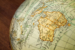 Old world globe: Australia. Detail of an old terrestrial globe showing Australia and surroundings royalty free stock image