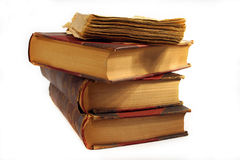 Old world knowledge. Stack of old books on white background royalty free stock image