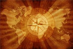 Old World Map. With Compass Rose. Grungy Old Paper World Map with Compass Stock Image
