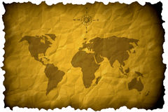Old world map. Burnt crumpled paper Stock Images
