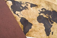 Old world map with book. Old time concept: old world map with book Royalty Free Stock Photos