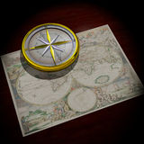Old World Map and Compass. 3D atmospheric image, old gold and silver compass sitting on old world map. Inscription on compass is quote from St Augustine - The Stock Photo