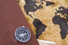 Old world map with compass. Old time concept: old world map with compass Royalty Free Stock Photography