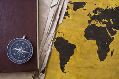 Old world map with compass. Old time concept: old world map with compass Royalty Free Stock Image
