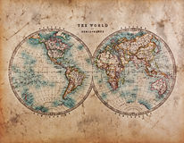 Old World Map in Hemispheres. A genuine old stained World map dated from the mid 1800s showing Western and Eastern Hemispheres with hand colouring royalty free stock photos