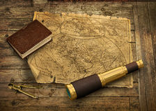 Old world map with telescope Stock Images
