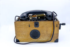 Old World War II military phone in wooden box. Royalty Free Stock Images