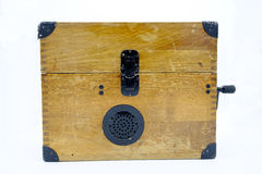 Old World War II military phone in wooden box. Royalty Free Stock Photos
