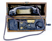 Old World War II military phone in wooden box. Stock Images