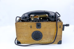 Old World War II military phone in wooden box. Stock Photography