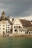 Old World Waterfront Village. Old world village on a waterfront under an overcast sky. Vertical shot Stock Image