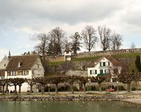 Old World Waterfront Village. Old world village on a waterfront under an overcast sky. Horizontal shot Stock Images