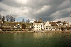 Old World Waterfront Village. Old world village on a waterfront under an overcast sky. Horizontal shot Stock Photography