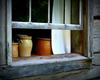 Pottery Window. Still Life looking in through a window at Old World Wisconsin Royalty Free Stock Photography
