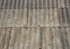 Old worn asbestos roof on small shelter Stock Photo
