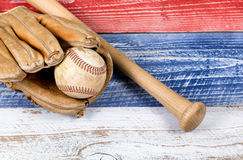 Old worn baseball equipment on faded boards painted in American Royalty Free Stock Images