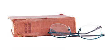 Old Worn Bible and Reading Glasses Royalty Free Stock Image