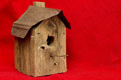 Old Worn Birdhouse - Isolated on Red Burlap Fabric Stock Photos