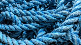 Worn blue rope. Old worn blue rope can be used as background or wallpaper and for other possibility to modify to your taste royalty free illustration