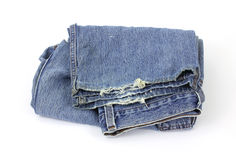 Old worn bluejeans. A pair of old worn bluejeans on a white background royalty free stock photography