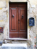Old, worn brown door. Royalty Free Stock Photography
