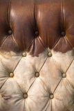 Old worn brown leather sofa vertical Royalty Free Stock Images