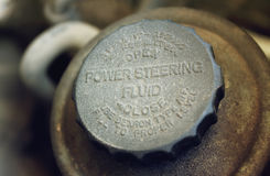 Old worn cap of power steering reservoir Royalty Free Stock Photos