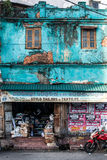 Old and worn colorful building. An old building in light blue. business on the ground floor. Urban scene in Galle, southern town in Sri Lanka stock photography