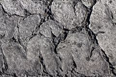 Old worn and cracked asphalt. With cracks Royalty Free Stock Image
