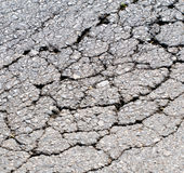 Old worn and cracked asphalt with cracks Royalty Free Stock Photos