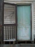 Old worn door. Old worn wooden door with broken screen Royalty Free Stock Photo