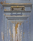 Old worn door and bronze handle detail Stock Image