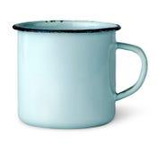 Old worn enameled mug. Isolated on white background Royalty Free Stock Image