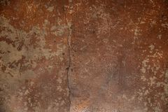 Old worn grungy cracked earth tone painted concrete floor background with brush marks and scratches.  royalty free stock images